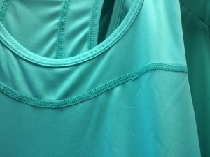 Women's Sugoi Top, Excess along stitch line